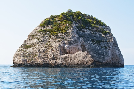 Small island in waters of Zakythos island in Greece  photo