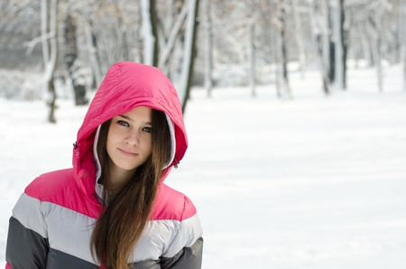 Beautiful girl portrait against winter forest photo