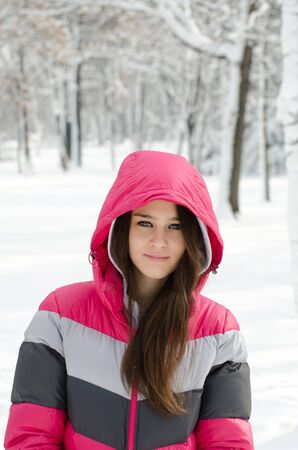Girl in winter forest photo