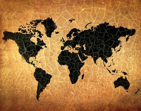 antique world map on grunge cracked paper photo