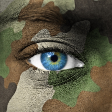 Army camouflage on human face photo