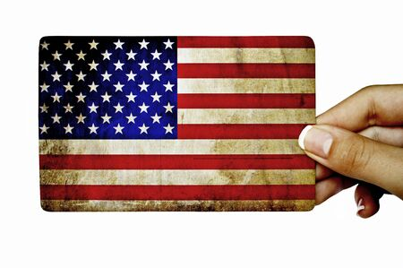 Hand holding grunge card with American flag photo