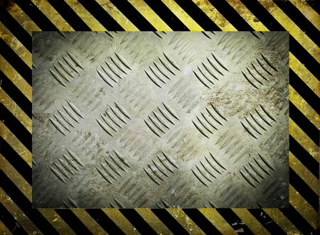 Diamond metal template with yellow warning stripes background photo