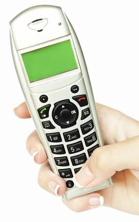 Hand holding phone isolated on white background Stock Photo - 12647325