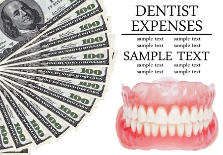 Denture and dollars  - Dental expenses conceptual image photo