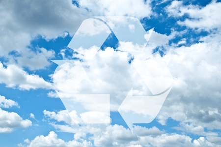 Recycle sign against blue sky with clouds photo