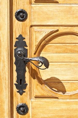 Wooden door with antique handle Stock Photo - 12990121