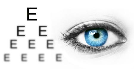 Eye test chart and blue human eye Stock Photo - 13329645