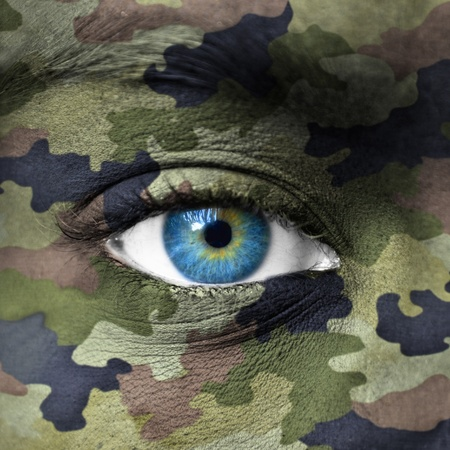 Army camouflage colors on human face photo