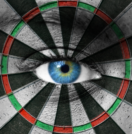 eyes looking up: Blue eye and dartboard Stock Photo