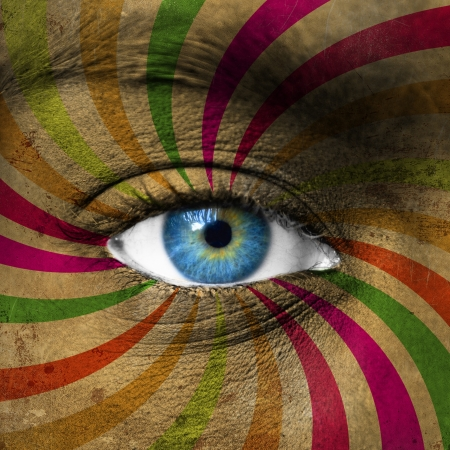 Blue eye and abstract colorful stripes photo