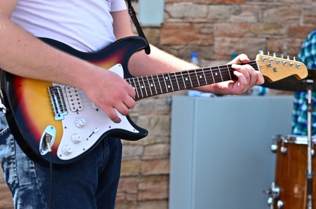 Man playing guitar closeup photo