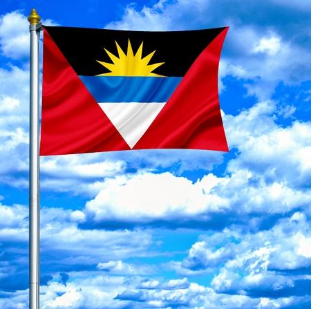 barbuda: Antigua and Barbuda waving flag against blue sky