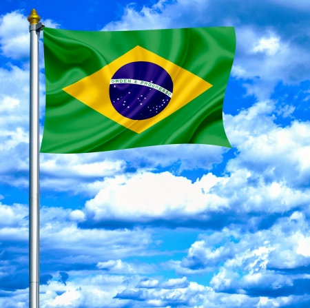 Brazil waving flag against blue sky photo