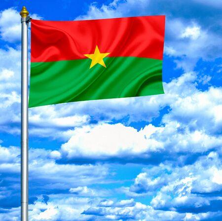 burkina faso: Burkina Faso waving flag against blue sky Stock Photo