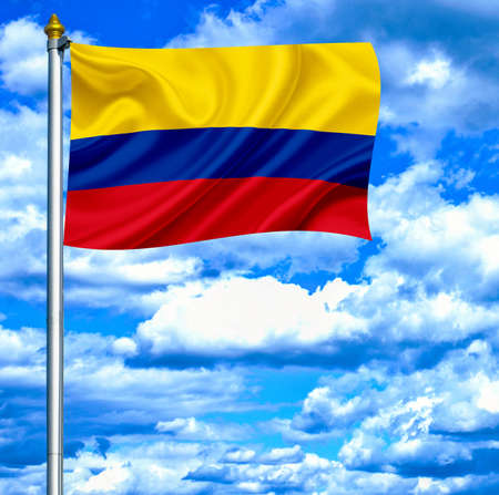 Colombia waving flag against blue sky photo