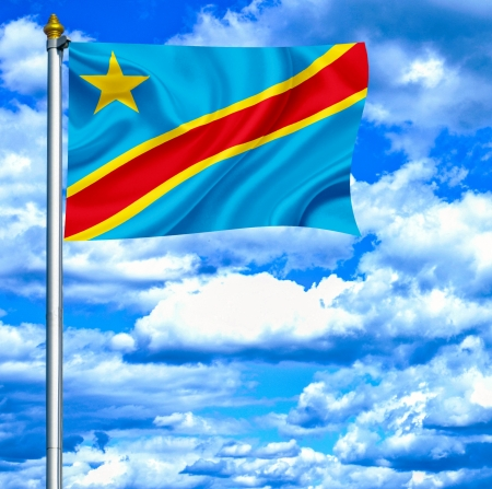 republic of the congo: Democratic Republic of Congo waving flag against blue sky Stock Photo