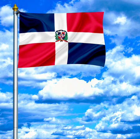 Dominican Republic waving flag against blue sky photo