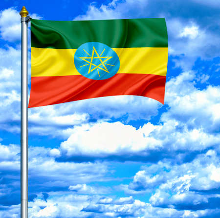 Ethiopia waving flag against blue sky photo