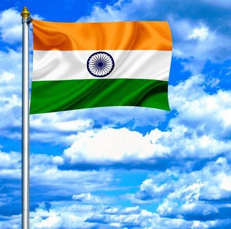 India waving flag against blue sky photo