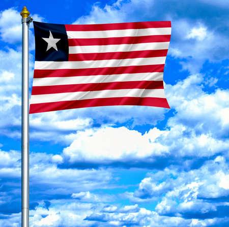 liberia: Liberia waving flag against blue sky