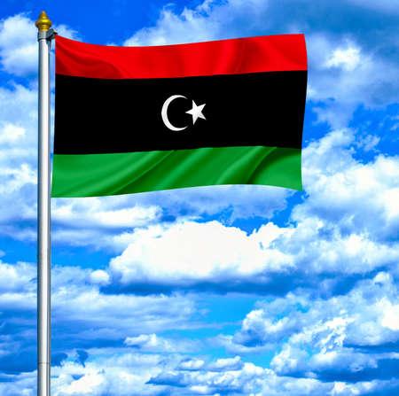 Libya waving flag against blue sky photo