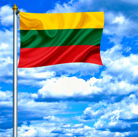Lithuania waving flag against blue sky photo