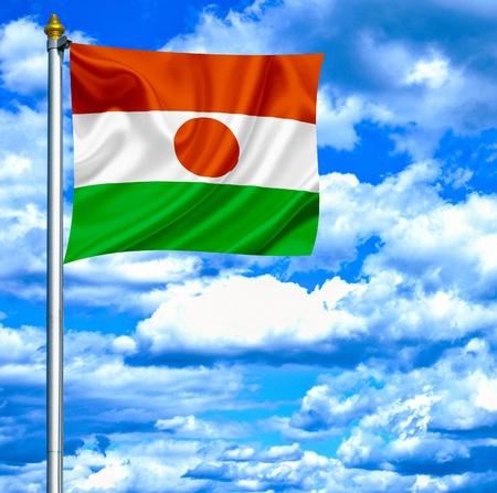 niger: Niger waving flag against blue sky