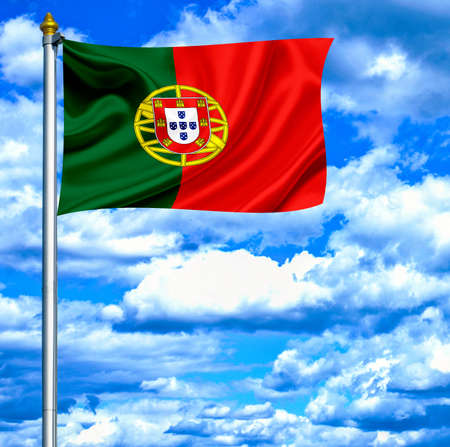 Portugal waving flag against blue sky photo