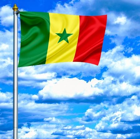 Senegal waving flag against blue sky photo
