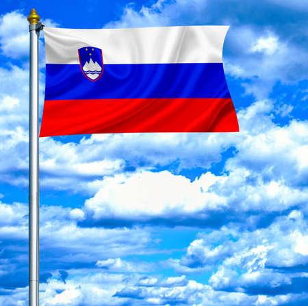 Slovenia waving flag against blue sky