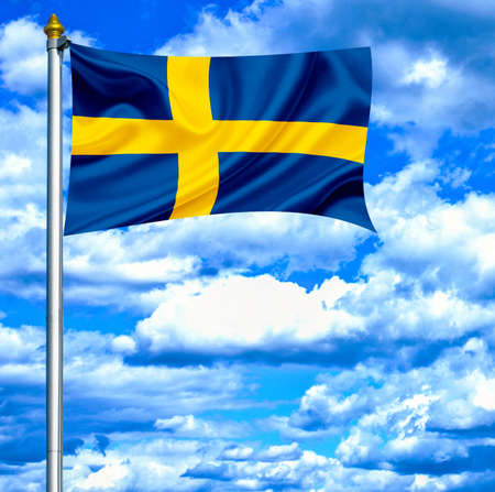 Sweden waving flag against blue sky photo