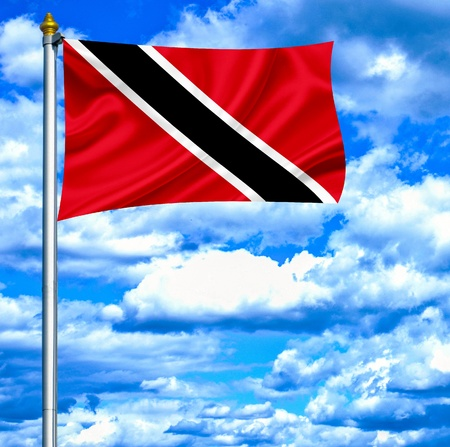 Trinidad and Tobago waving flag against blue sky photo