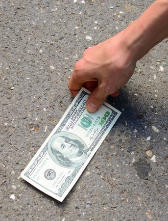 Hand picking money from street floor - Finding money on street concept Stock Photo - 14058961