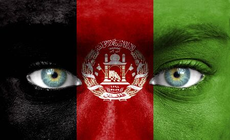 Human face painted with flag of Afghanistan photo