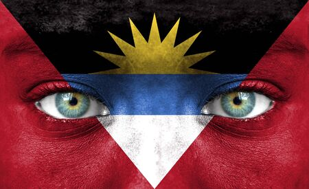 antigua flag: Human face painted with flag of Antigua and Barbuda Stock Photo