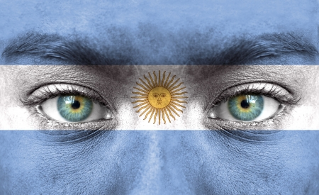 argentina: Human face painted with flag of Argentina Stock Photo