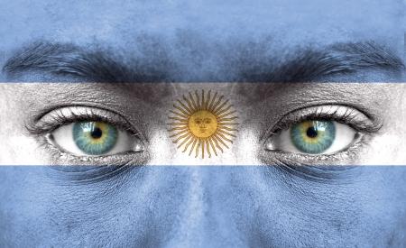 bandera argentina: Rostro humano pintado con la bandera de la Argentina
