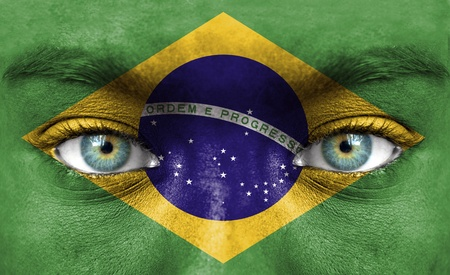Human face painted with flag of Brazil photo