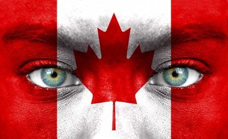 Human face painted with flag of Canada photo