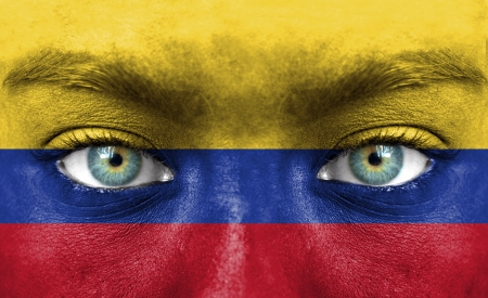 colombia: Human face painted with flag of Colombia Stock Photo