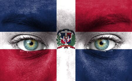 Human face painted with flag of Dominican Republic