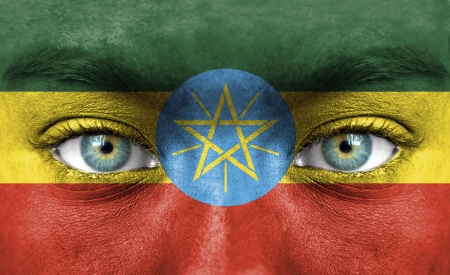 Human face painted with flag of Ethiopia Stock Photo - 14256330