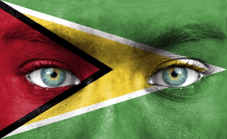 Human face painted with flag of Guyana Stock Photo - 14256245