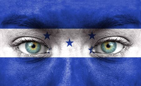 honduras: Human face painted with flag of Honduras