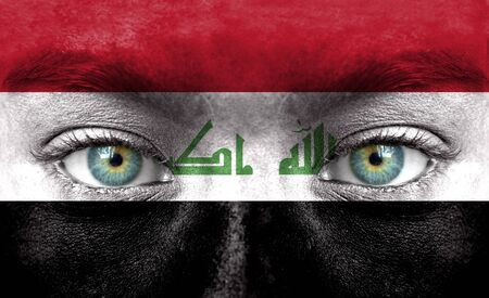 iraq flag: Human face painted with flag of Iraq