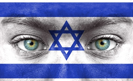 israel flag: Human face painted with flag of Israel