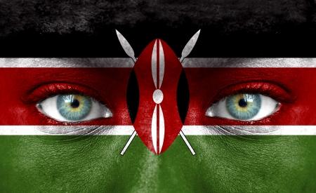 adult kenya: Human face painted with flag of Kenya