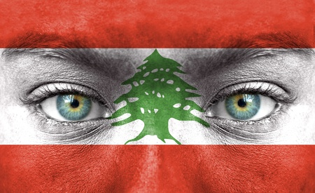 lebanon: Human face painted with flag of Lebanon