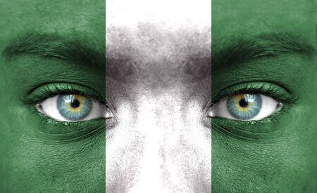nigeria: Human face painted with flag of Nigeria